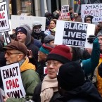 Protestors rally in Chicago's Magnificent Mile shopping district calling for an elected civilian police oversight council. Protestors also decried fatal shootings by Chicago police that occurred Wednesday night and Friday morning.