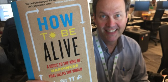 "Jerome McDonnell with a copy of Colin Beavan's ""How to be Alive"""