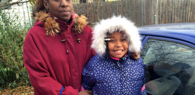 Angel Hinton with her daughter, Cameisha, 8. Hinton's business suffered after her license was suspended.