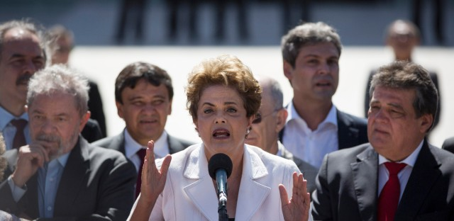 """Brazil's President Dilma Rousseff speaks after leaving Planalto presidential palace in Brasilia, Brazil, Thursday, May 12, 2016. Speaking hours after the Senate voted to suspend her on Thursday, Rousseff blasted the impeachment process as """"fraudulent"""" and promised to fight what she characterized as an injustice more painful than the torture she endured under a past military dictatorship."""