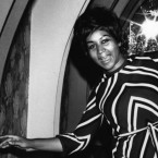 Aretha Franklin poses