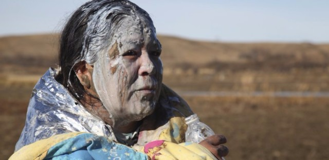 Tonya Stands recovers from being pepper sprayed by police after swimming across a creek with other protesters hoping to block construction of the Dakota Access Pipeline, near Cannon Ball, N.D., on November 2.