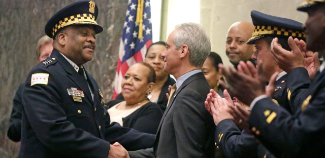 Chicago Mayor Rahm Emanuel shakes hands with Eddie Johnson after swearing him in as the new Chicago police superintendent in Chicago. Aldermen say Emanuel is willing to compromise on his proposal for a new police accountability system.