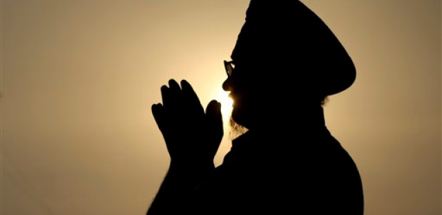An Indian Sikh devotee offers prayers at the Golden Temple, Sikh's holiest shrine in Amritsar, India, Monday, Aug. 6, 2012.Indian Prime Minister Manmohan Singh said Monday that he was shocked and saddened by the shooting attack that killed six people at a Sikh house of worship in Wisconsin.