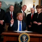 President Donald Trump speaks before he signs a presidential memorandum imposing tariffs and investment restrictions on China in the Diplomatic Reception Room of the White House, Thursday, March 22, 2018, in Washington.