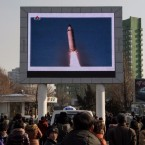 On Feb. 13, people in Pyongyang watch a public broadcast about the Feb. 12 launch of a long-range ballistic missile at an undisclosed location — the first fired in Donald Trump's presidency. The U.N. Security Council on Feb. 13 unanimously condemned the missile test by North Korea.