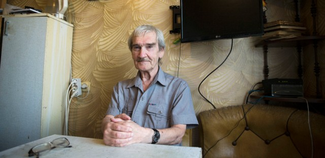 In this Thursday, Aug. 27, 2015 photo former Soviet missile defense forces officer Stanislav Petrov poses for a photo at his home in Fryazino, Moscow region, Russia. On Sept. 26, 1983, despite the data coming in from the Soviet Union's early-warning satellites over the United States, Petrov, a Soviet military officer, decided to consider it a false alarm. If he had decided otherwise, the Soviet leadership could have responded by ordering a retaliatory nuclear strike on the United States.