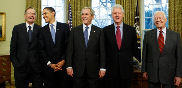 Barack Obama is welcomed into the 'Presidents Club' by former presidents George W. Bush, George H.W. Bush, Bill Clinton and Jimmy Carter.