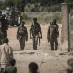 Children watch Senegalese soldiers on Friday in the town of Karang, Senegal, near the border with Gambia.