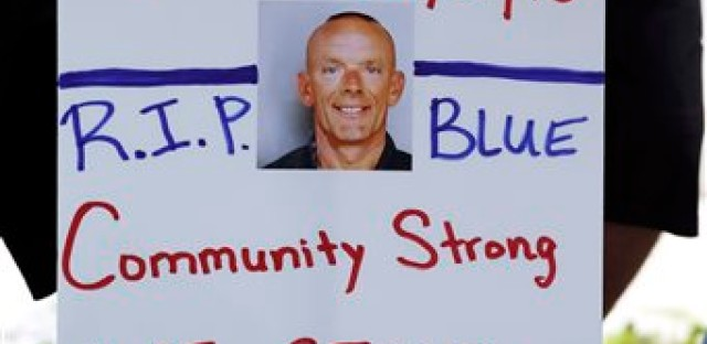 Residents show their support outside the Fox Lake Police department as the manhunt continued for three suspects thought to be the murderers of Gliniewicz.