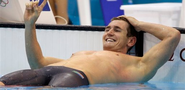 South Africa's Cameron van der Burgh celebrates after winning the men's 100-meter breaststroke swimming final on Sunday, July 29, 2012.