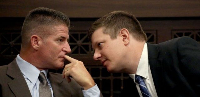 Police officer Jason Van Dyke, right, speaks with attorney Daniel Herbert at a pretrial hearing July 19, 2017, at the Leighton Criminal Courts Building in Chicago. Van Dyke faces murder charges in Laquan McDonald's death.