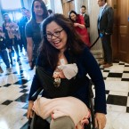 "Sen. Tammy Duckworth, D-Ill., arrives at the Senate with her new daughter, Maile Pearl, during the vote on Mike Pompeo to be President Donald Trump's second secretary of state on April 26, 2018, which is ""Take Our Daughters And Sons To Work Day."" (AP Photo/J. Scott Applewhite)"