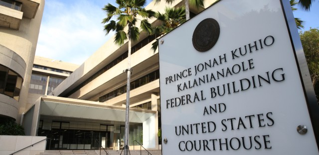 A sign for the Hawaii U.S. federal court stands outside the building in Honolulu on Wednesday morning, March 15, 2107. Legal efforts to overturn President Donald Trump's travel ban will be held Wednesday in Hawaii. The lawsuit claims the ban harms Hawaii by highlighting the state's dependence on international travelers, its ethnic diversity and its welcoming reputation as the Aloha State.