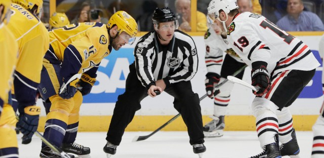Linesman Trent Knorr (63) prepares to drop the puck for a face-off between Nashville Predators center Mike Fisher (12) and Chicago Blackhawks center Jonathan Toews (19) during the first period in Game 4 of a first-round NHL hockey playoff series Thursday, April 20, 2017, in Nashville, Tenn. (AP Photo/Mark Humphrey)