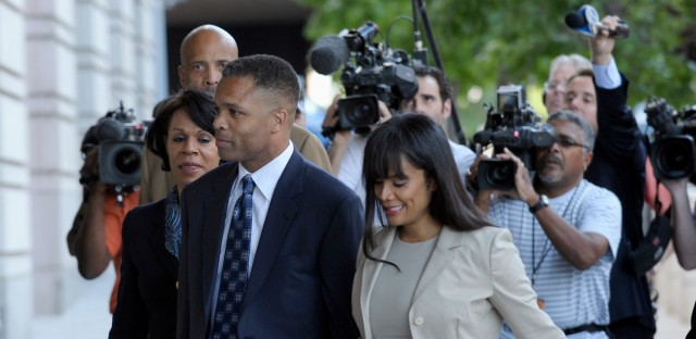 In this Aug 14, 2015 file photo, former Illinois Rep. Jesse Jackson Jr. and his wife, Sandra, arrive at federal court in Washington. The Bureau of Prisons says former U.S. Rep. Jesse Jackson Jr. has officially completed his 2 ½-year prison sentence for spending $750,000 in campaign money on personal items. Bureau spokesman Edmond Ross says the Illinois Democrat's home confinement in Washington, D.C., will be lifted Friday and his ankle monitor removed. With Jackson's freedom, his wife will have to report to prison soon to serve a one-year sentence on a tax conviction related to the campaign money.
