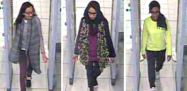 This Monday Feb. 23, 2015 file handout image of a three image combo of stills taken from CCTV issued by the Metropolitan Police shows Kadiza Sultana, left, Shamima Begum, center, and Amira Abase going through security at Gatwick airport, south England, before catching their flight to Turkey. Shamima Begum told The Times newspaper in a story published Thursday Feb. 14, 2019, that she wants to come back to London.