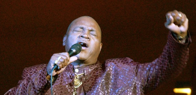 "Slinger Francisco, also known as ""The Mighty Sparrow,"" and the king of Calypso sings during a concert celebrating Haiti's bicentennial at Carnegie Hall in New York Saturday, Jan. 3, 2004."