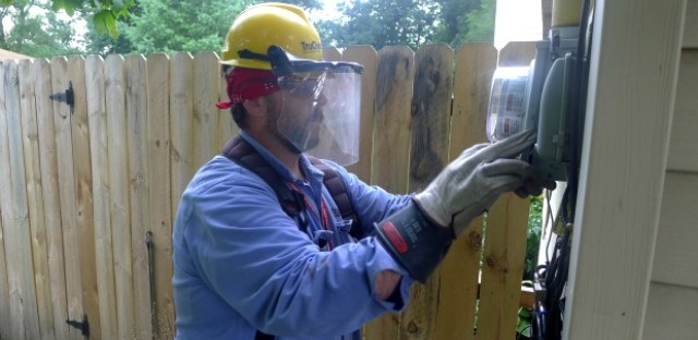 Tommy Hemphill works to install a new advanced meter reading device at a home in Porter, Indiana. Hemphill works for Northern Indiana Public Service Company, or NIPSCO for short. Although these new meters are not considered smart meters, they will allow the company to better track energy usage by customers.