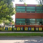 The sign outside Fulton Elementary, which for decades had been a predominantly African-American school, welcomes students in Spanish. Fulton is now 58 percent Latino.