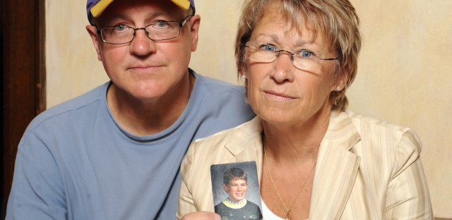 In this 2009 photograph, Patty and Jerry Wetterling show a photo of their son Jacob, who was abducted in 1989 in St. Joseph, Minn. Local authorities announced Saturday that his remains have been found.