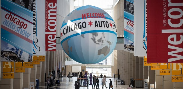 Guests pass under signage during the media preview of the Chicago Auto Show at McCormick Place in 2015.