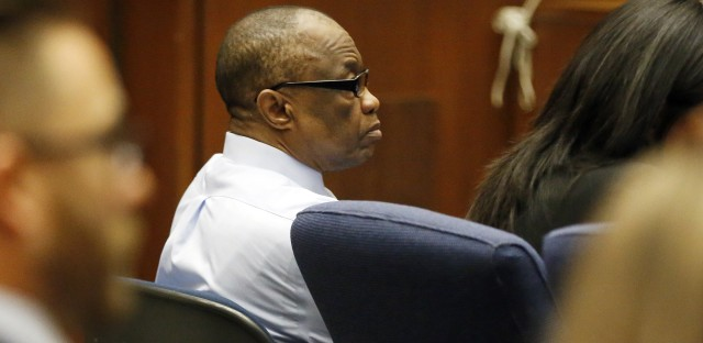 Defendant Lonnie Franklin Jr. listens during opening statements of his trial. Franklin is accused of serial murders that terrorized South LA.