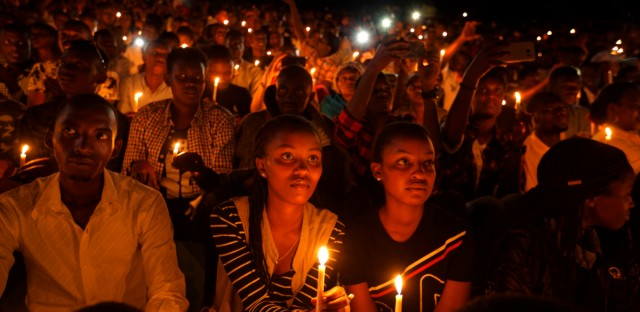 Rwandans sitting in the stands hold candles as part of a candlelit vigil during the memorial service held at Amahoro stadium in the capital Kigali, Rwanda Sunday, April 7, 2019. Rwanda is commemorating the 25th anniversary of when the country descended into an orgy of violence in which some 800,000 Tutsis and moderate Hutus were massacred by the majority Hutu population over a 100-day period in what was the worst genocide in recent history.