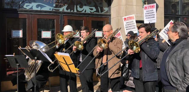 CSO musicians perform last Tuesday at the Michigan Avenue entrance of Symphony Center.