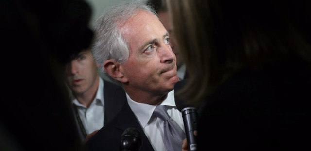 Sen. Bob Corker, R-Tenn., speaks to reporters on Capitol Hill about President Trump on Tuesday morning, ahead of Trump's visit with GOP senators. Win McNamee/Getty Images