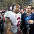 Alabama running back Derrick Henry celebrates with teammates and reporters after the College Football Playoff national championship game between the Alabama Crimson Tide and the Clemson Tigers earlier this year.