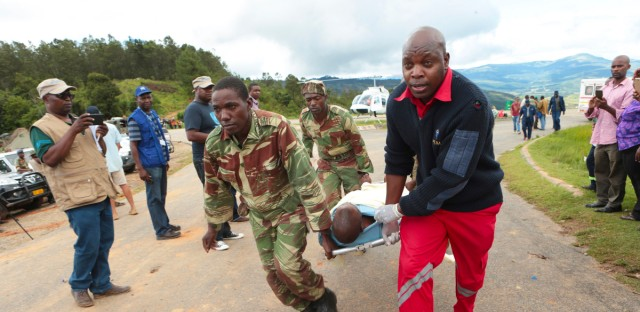 Soldiers and paramedics carry injured survivors from a helicopter in Chimanimani about 600 kilometres south east of Harare, Zimbabwe, Tuesday, March, 19, 2019. According to the government, Cyclone Idai has killed more than 100 people in Chipinge and Chimanimani and according to residents the figures could be higher because the hardest hit areas are still inaccesible. Some hundreds are dead, many more are missing, and some thousands at risk from the massive flooding in Mozambique, Malawi and Zimbabwe caused by Cyclone Idai.