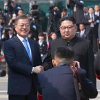 North Korean leader Kim Jong Un, right, poses with South Korean President Moon Jae-in for a photo at the border village of Panmunjom in the Demilitarized Zone Friday, April 27, 2018.