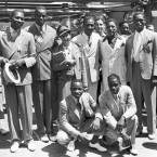 At the 1936 Olympics, 18 black athletes went to Berlin as part of the U.S. team. Pictured here are (left to right, rear) high jumpers Dave Albritton and Cornelius Johnson; hurdler Tidye Pickett; sprinter Ralph Metcalfe; boxer Jim Clark; sprinter Mack Robinson. In front: weightlifter John Terry (left); long jumper John Brooks.
