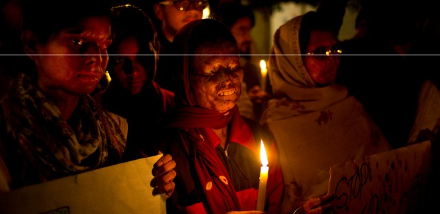 Acid attack survivors participate in a candlelit vigil protesting violence against women as they mark the second anniversary of the deadly gang rape of a student on a bus, in New Delhi, India. Chicago will host the first conference to focus on issues facing South Asian women and girls.