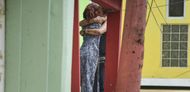 Residents at La Perla community in Old San Juan comfort one another as the community recovers from Hurricane Maria, in San Juan, Puerto Rico, Monday.