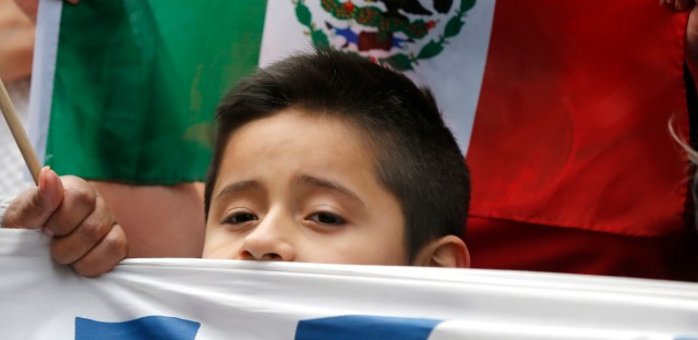 A boy joins others participating in a protest and marching aimed at President Donald Trump's nationwide efforts to crack down on immigration in Chicago on Feb. 16, 2017. (AP Photo/Charles Rex Arbogast File)