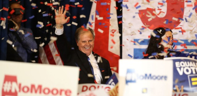 Democratic Sen.-elect Doug Jones greets supporters during his election night gathering last month. Justin Sullivan/Getty Images