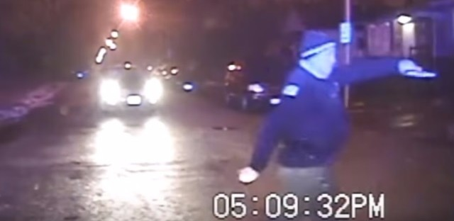A screen grab from a 2013 dashcam video shows Chicago police officer Marco Proano before he opens fire on a car.