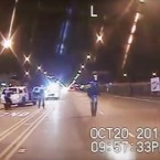 In this frame from dash-cam video provided by the Chicago Police Department, 17-year-old Laquan McDonald, right, walks down the street moments before being shot by white officer Jason Van Dyke in Chicago. The Task Force on Police Accountability recommends abolishing the Independent Police Review Authority, which investigates officer misconduct. The panel was created in the wake of protests over Van Dyke's fatal shooting of McDonald.