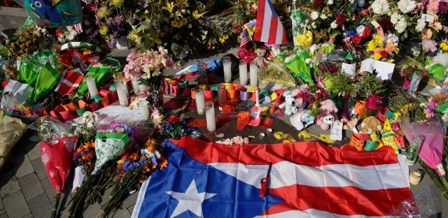 A Puerto Rican flag is left at a makeshift memorial near Orlando Regional Medical Center, down the street from the crime scene at Pulse Nightclub.