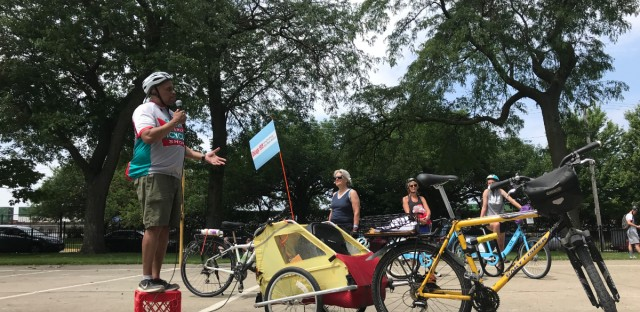 University of Chicago historian Franklin Cosey-Gay speaks to bike tour participants at Armour Square Park in Bridgeport, Saturday, June 29.
