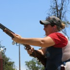 Kim Rhode takes practice shots with the assist of her father Richard Rhode, who's been her coach for 27 years.