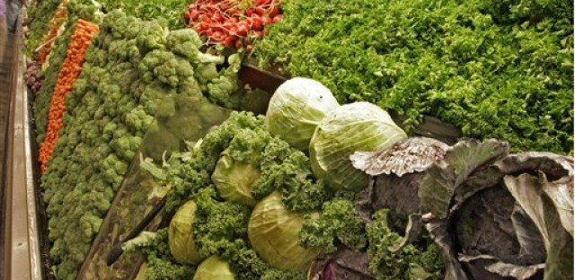 Cabbages, salad greens, radishes and broccoli are among the selection of organic produce on sale at a Whole Foods Market.