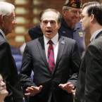 David Shulkin, center, the U.S. Department of Veterans Affairs undersecretary of health, talks with attendees in July prior to testifying at a Senate Veterans' Affairs Committee hearing in Gilbert, Ariz. Donald Trump has selected Shulkin to lead the agency.