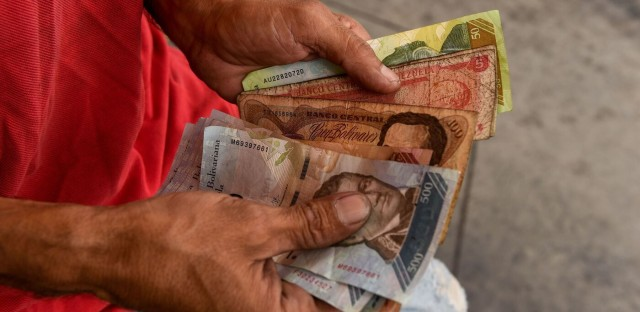 Planet Money : #858:  Venezuela's Fugitive Money Traders Image