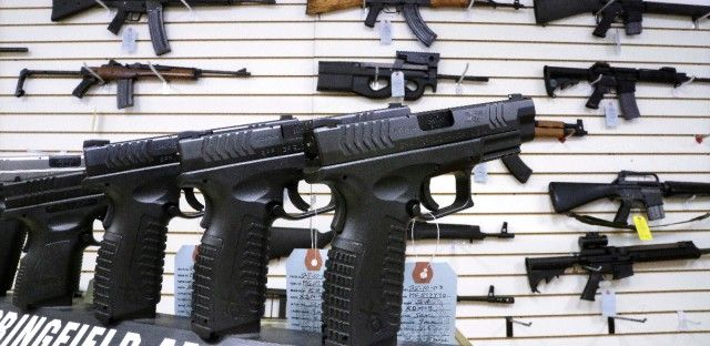 Assault weapons and hand guns are seen for sale at Capitol City Arms Supply in Springfield, Illinois, on Jan. 16, 2013.