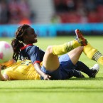 Great Britain's Eniola Aluko, top, vies for the ball with Sweden's Antonia Goransson, bottom, during their Olympic Women's friendly soccer match at the Riverside Stadium, Middlesbrough, England, Friday, July 20, 2012.