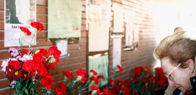 A relative of a bombing victim prays in El Pozo train station in Madrid, Spain, Sunday, March 11, 2007.