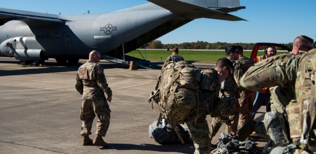 This Oct. 29, 2018 photo provided by the U.S. Air Force shows deployers from Headquarters Company, 89th Military Police Brigade, Task Force Griffin get ready to board a C-130J Super Hercules from Little Rock, Arkansas, at Fort Knox, Kentucky, in support of Operation Faithful Patriot. The Trump administration on Monday, Oct. 29, 2018, announced plans to deploy 5,200 active duty troops, double the 2,000 who are in Syria fighting the Islamic State group, to the border to help stave off the caravans. The main caravan, still in southern Mexico, was continuing to melt away, from the original 7,000 to about 4,000, as a smaller group apparently hoped to join it.
